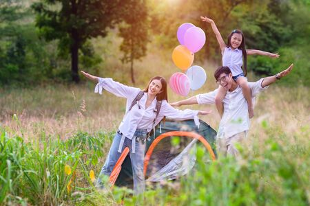 group of warm family enjoy playing together in wildflowers meadow field at light of sun nature 写真素材