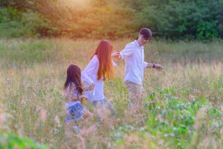 group of family holding hand together walks to the successfully light of destination