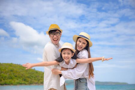 Happy family are enjoy trip of the sea beach together in vacation and long holidays