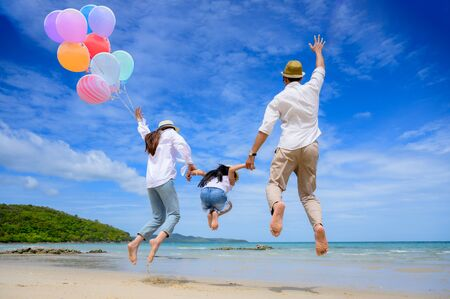 Group of happy family are enjoy trip of the sea beach together in vacation and long holidays