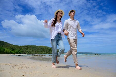 Couple lover enjoy running together on the sea beach, same direction of life go ahead together future
