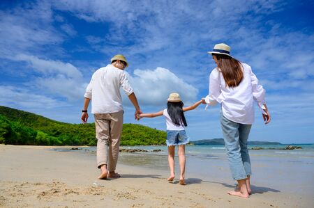 Parent father and mother help to holding hand of kid, care and always support to success destination of life, enjoy hold hand together on the sea beach