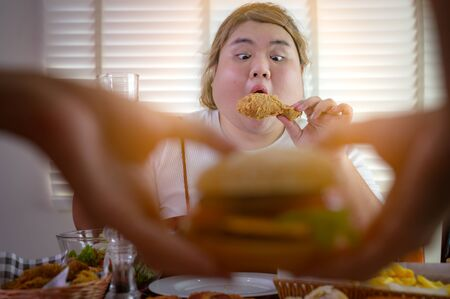 plump fatty woman hunger eating a lot junk food