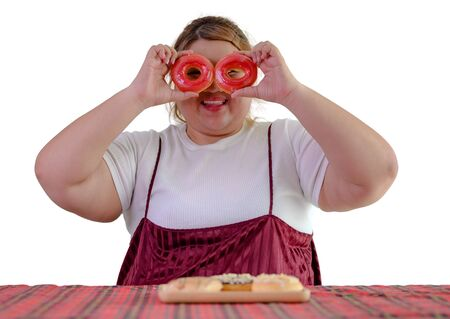 isolate of plump fatty woman hunger eating a lot junk food with high calories od sweet donut Banco de Imagens