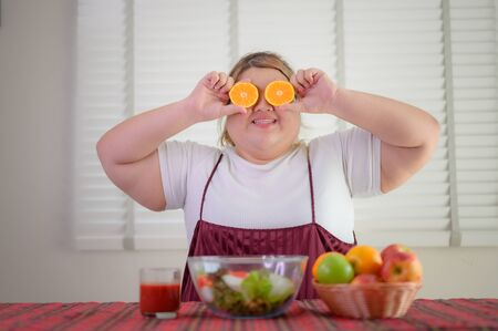 plump fatty woman loves and enjoy salad fruits meal Banco de Imagens