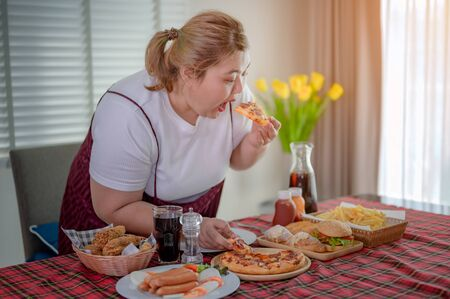 plump fatty woman hunger enjoy eating a lot junk food with high calories