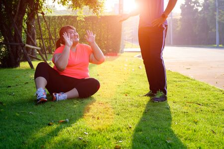 Fat plump woman anti and boring jogging exercise, upset hate running jogging, refused trainer exercise
