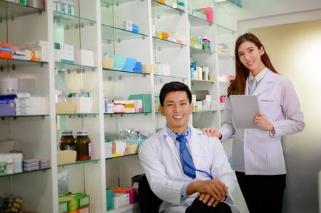 woman and man pharmacist standing by in pharmacy drug store for medical consultant Stok Fotoğraf