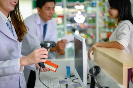 pharmacist in charge paying of medicine cost at pharmacy counter Stok Fotoğraf - 132932203