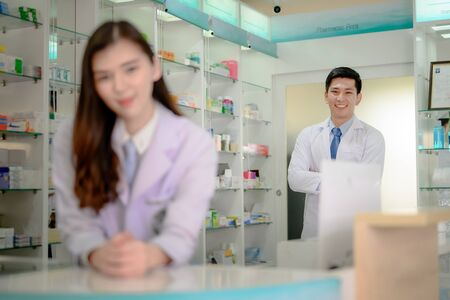 man and woman stand by in charge in pharmacy drug store Stock fotó - 131835299
