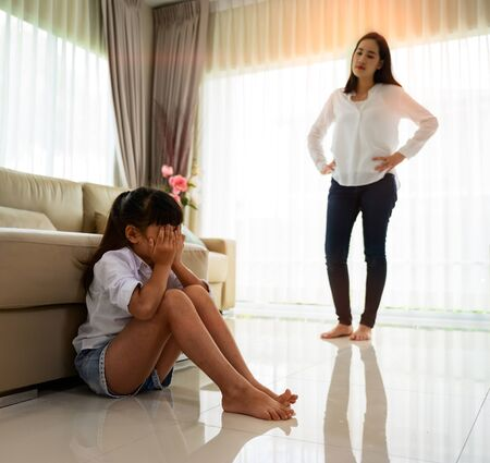 daughter in upset and argument with mother, mom in scream and shouting a naughty girl