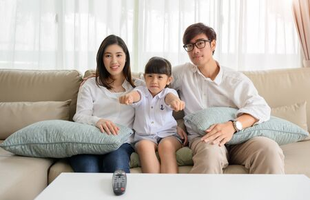 happy family watching TV entertainment together in living room at holiday time weekend, keep watching and teach family member in appropriate content