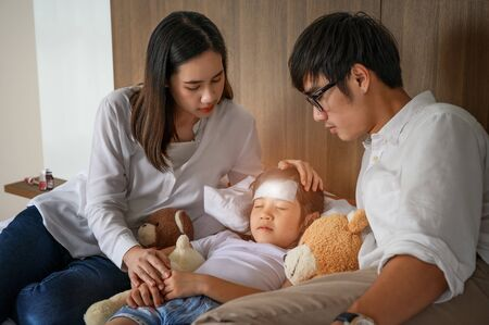 family takes care of member sick in bedroom, worry and keep close looing for effective future