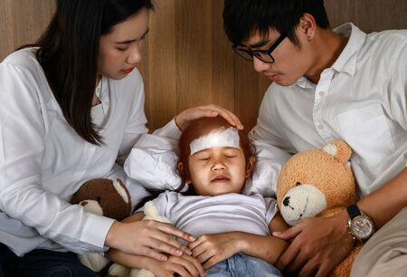 family takes care of member sick in bedroom, worry and keep close looking for effective future Stock Photo