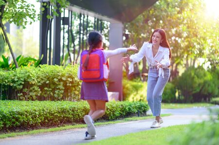 Mom mother in motion of happy by opening arm welcome home of daughter, girl daughter exciting in returns home after school study Stock Photo