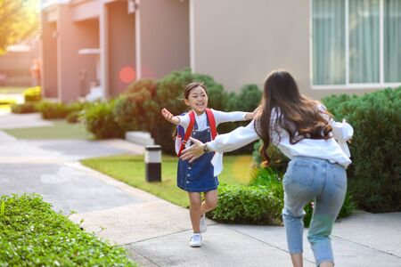 Girl in emotion happiness in returning home after school study