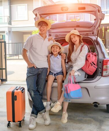 Family prepare and arrange luggages and packing ready to traveling outdoors journey in summer time long weekend vacations, coverage insurance through the trip for safety life