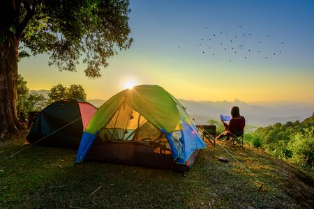 woman traveller camping in campsite with freshly morning action