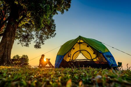 silhouette of woman traveller camping in campsite with freshly morning enjoy action