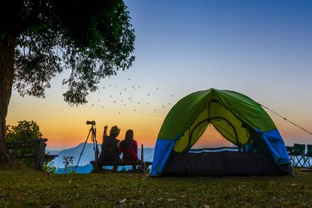 woman and man couple lover or traveller camping in campsite with freshly morning action exciting  Stok Fotoğraf