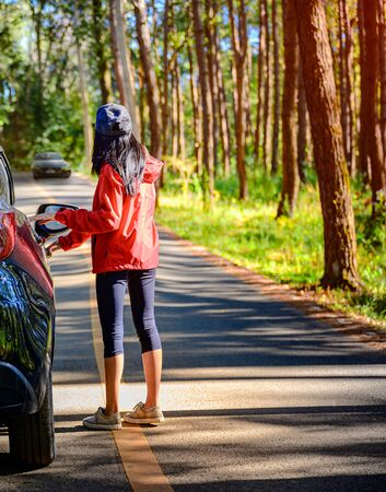 woman driver waiting for helper on car engine breaking out of order in forest of Countryside Stok Fotoğraf