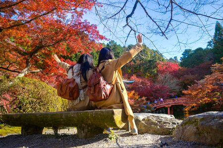Woman traveller tourist enjoy and happiness to see the scenery view of autumn village in Japan countryside, Autumn season change blooming on popular and famous place for tourist visit Japan  Stockfoto