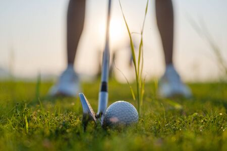 golf ball laying in the rough o grass meadow out of the fairway, being hit by the golfer revert to the fairway, difficult time of life find success forward Stock Photo