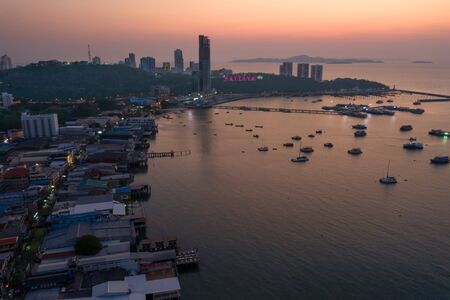 Aerial view of Pattaya city in night life at time critical of COVID 19 infection, effective of virus infect in the night business at popular and famous place of the World