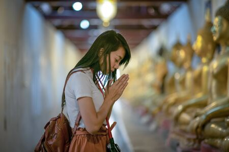 Woman pray respect to the buddha statue in the temple, Thai and Asia traditional and culture in religion spiritual