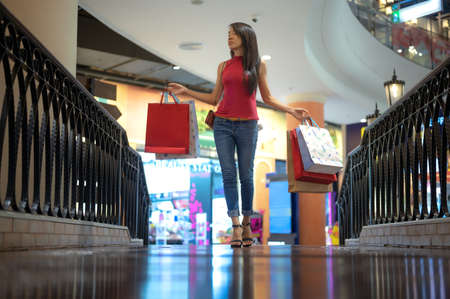 slim woman holding shopping bags satisfy and happy enjoy walks in mall department store on interesting lady goods attractive.
