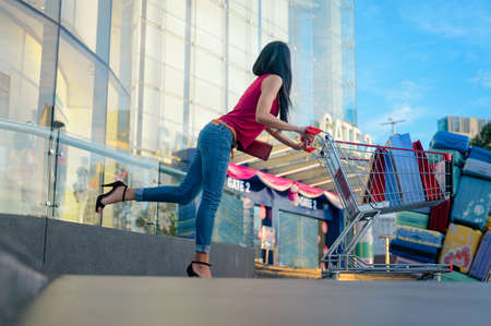 Woman fashion enjoy with time happy in department store shopping mall, spend consumption on shopping center mostly happiness time