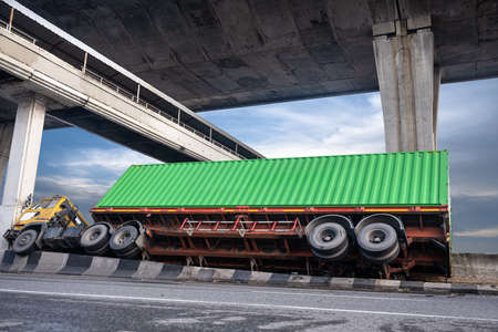 trailer truck clash on accident on the street under transport cargo container delivery to destination, driving at risk and high level of insurance Archivio Fotografico