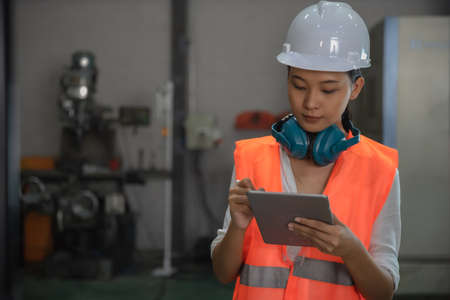 women working engineering or technical inspection the system  of machinery to ensure working in order by checklist part and quality control 스톡 콘텐츠 - 155062627