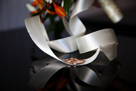 marriageable: wedding rings on a ribbon bridal bouquet Stock Photo