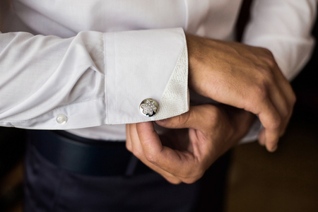 cuff link: men wear a shirt and cufflinks, correct clothes, dressing