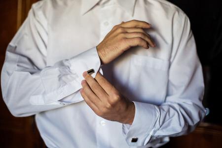 wrist cuffs: men wear a shirt and cufflinks, correct clothes, dressing
