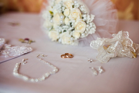 shiny background: Wedding rings on a white background, infinity sign of the rings, wedding rings and jewelry bride