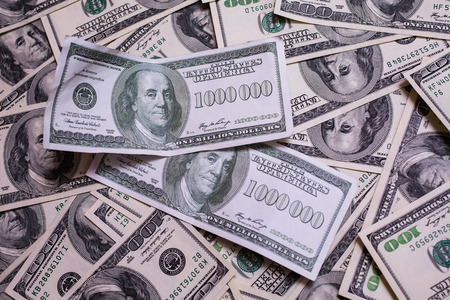 dollars: bill of one million dollars, a new brilliant idea, a million dollars, the thirst for wealth, success, get rich millionaire, background of the money, hundred dollar bills front side. background of dollars, old hundred-dollar bill face