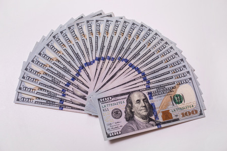 bil: background of the money, hundred dollar bills front side. background of dollars, new hundred-dollar bil face, the evolution of the bill in one hundred dollars, fan of money, dollars currency isolated, fan from american dollars banknotes. Isolate on white.