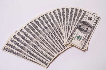 dollars: background of the money, hundred dollar bills front side. background of dollars, old hundred-dollar bil face, fan from american dollars banknotes. Isolate on white.