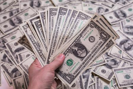 money pocket: fan de dinero, un ventilador de billetes de un d�lar, la cara billete de un d�lar, sed de riqueza, detalle, el alquiler, dinero de bolsillo, fondo de dinero Foto de archivo
