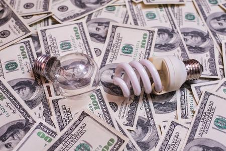 energy savings: energy saving lamp, incandescent, fluorescent, energy saving, saving electricity, money background, Eco energy saving light bulb, comparison of energy saving lamps and incandescent lamps Stock Photo