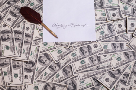 bil: fountain pen on the background of money, hundred dollar bills front side. background of dollars, old hundred-dollar bil face, motivation, success, you can be rich copyspace