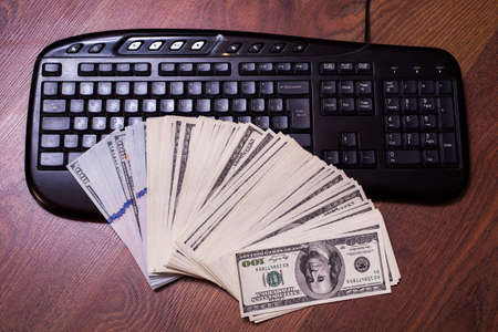 bil: keyboard and money, a place for records, business plan, money background, hundred dollar bills front side. background of dollars, new hundred-dollar bil face, copyspace, earnings in the Internet Stock Photo