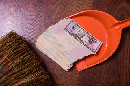 monetary devaluation: money in the scoop, shovel, broom and money, business plan, money background, hundred dollar bills front side. background of dollars, revenge money, earn a lot