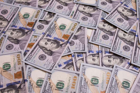 bil: background of the money, hundred dollar bills front side. background of dollars, new hundred-dollar bil facel, the evolution of the bill in one hundred dollars Stock Photo