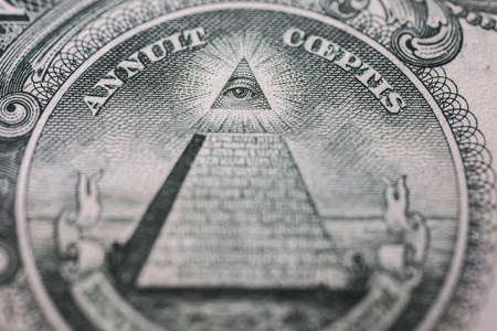 truncated: all-seeing eye, truncated pyramid closeup, money background ,one dollar bill down back reverse side, background of dollars, close up, America