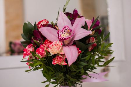 Wedding flowers wedding bouquet of red and pink peach yellow stock photo wedding flowers wedding bouquet of red and pink peach yellow roses and blue violet purple orchid bouquet of blue purple purple flowers mightylinksfo