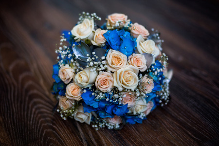 Wedding flowers bouquet of pink roses and blue flowers roses 53199860 wedding flowers bouquet of pink roses and blue flowers roses preparing for the wedding wedding bouquet mightylinksfo
