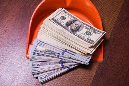 earn money: money in the scoop, shovel, broom and money, business plan, money background, hundred dollar bills front side. background of dollars, revenge money, earn a lot